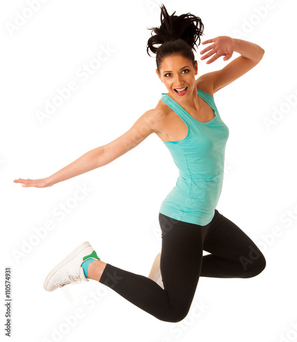 Happy fit and slim woman dancing and jumping isolated over white