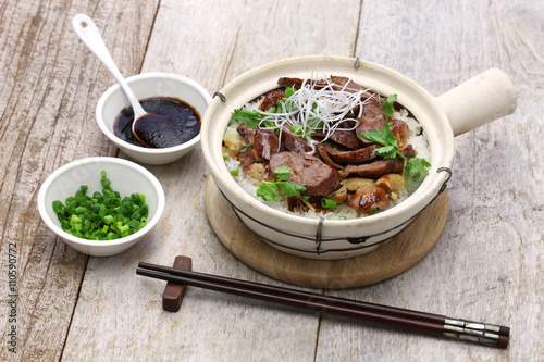 chinese sausage and chicken with rice in clay pot, cantonese food Poster