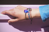Stylish bracelets on female hand - top view