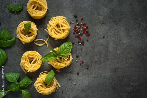 Fotografiet Ingredients for cooking Italian pasta