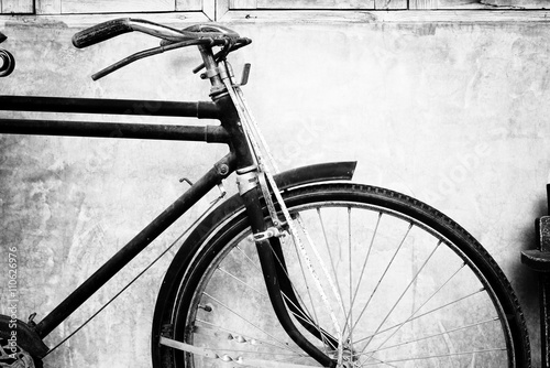 Black and white photo of vintage bicycle - film grain filter effect styles © jakkapan