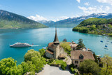 Fototapety Spiez castle with cruise ship on lake Thun in Bern, Switzerland