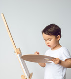 Child drawing on the easel