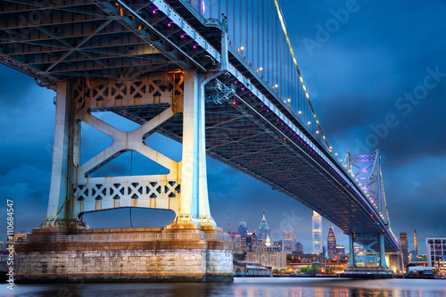 Poster Ben Franklin Bridge above Philadelphia skyline at dusk, US