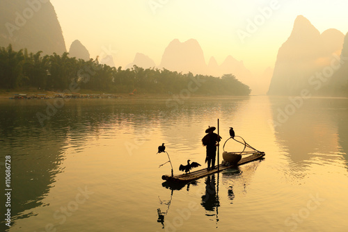 Poster Guilin Huangbu (Yellow Cloth) Beach Sunrise on Li River, Xingping, Guilin, China. Xingping is a town in North Guangxi, China. It is 27 kilometers upstream from Yangshuo on the Li River