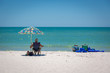 Naples, Florida - May 18th 2014 - People enjoying a beautiful blue sky day in the beach of Naples in Florida, USA