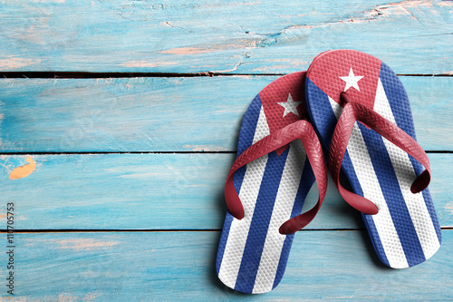 Thongs with flag of Cuba, on blue wooden boards