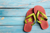 Thongs with flag of Vietnam, on blue wooden boards