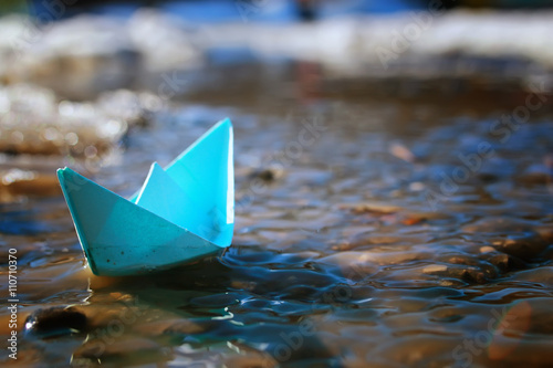 tinted photo paper boat on spring street © alexkich