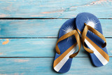 Thongs with flag of Marshall Islands, on blue wooden boards
