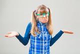 Studio shot portrait of confused nerdy woman