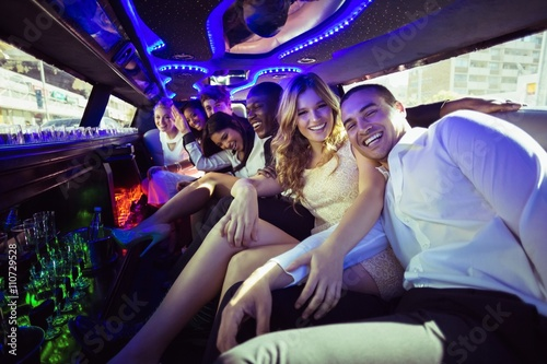 Happy friends chatting in limousine Poster