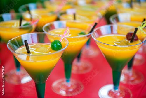 Fototapeta yellow green cocktail with cherry