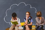 Composite image of schoolchildren reading and thinking