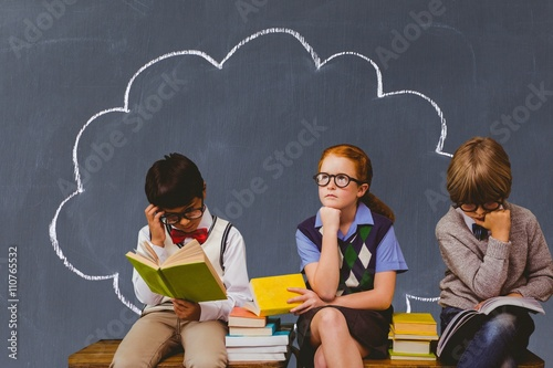 Composite image of schoolchildren reading and thinking Poster