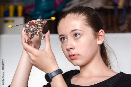 Zdjęcia Young girl with ponytail playing with toy airplane