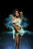 Young woman with colored powder exploding around her - 110812722