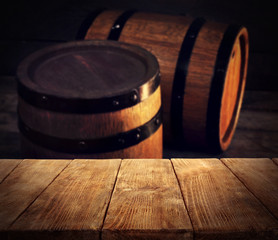 Barrels of wine and empty wooden desk