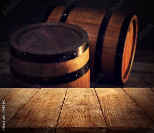 Barrels of wine and empty wooden desk © Africa Studio