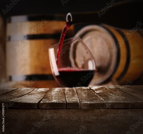 Barrels of wine and empty wooden desk