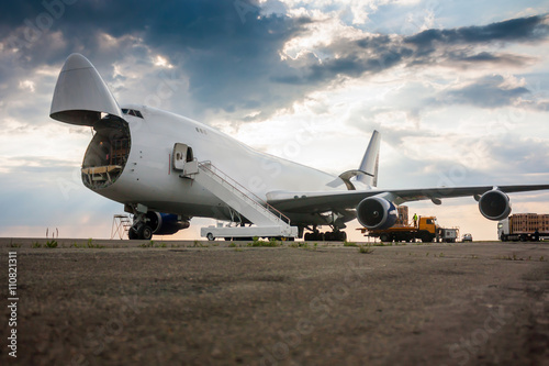 Poster Unloading wide body cargo airplane