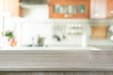 Fototapety Blurred background. Modern kitchen with tabletop and space for you.