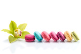 Fototapety Colorful macarons line and Cymbidium orchid isolated on white ba