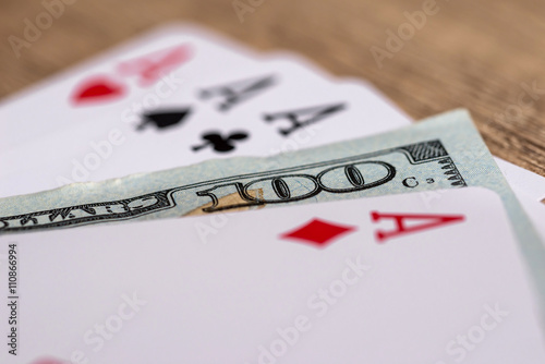 Poster four poker aces with 100 dollar bills