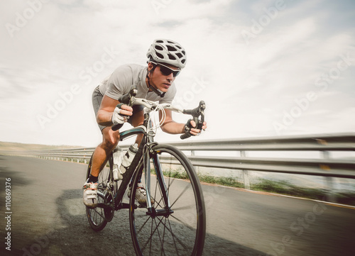 Poster, Tablou Cyclist pedaling on a racing bike outdoor