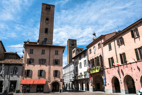 Poster Square and towers in Alba, Italy