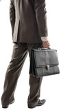 Back view of businessman with suitcase in hand