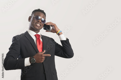 Plakát Young african American man using a mobile phone