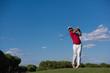 golf player hitting long shot