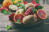 Concept of vegan eating with fresh fruits