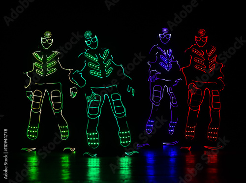 dance team in costumes of the LEDs Poster
