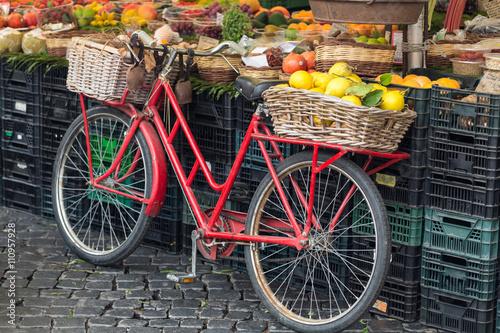 retro red bike in fruit market Campo dei Fiori in Rome