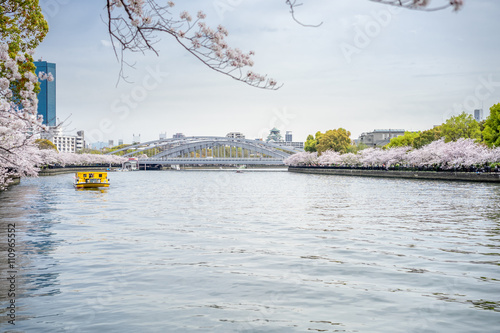 Poster View of the yellow tourist boat in the river and the bridge from