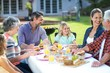 Happy multi-generation family sitting at table