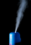 Spray air freshener isolated on a black background