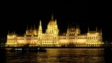Tourist on the Boat Make Photo the Parliament of Budapest in the Night.