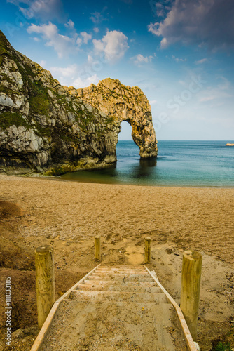 Poster Durdle Door famous rock formation in Dorset
