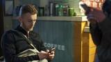 man using a smartphone at the cafeteria slow motion