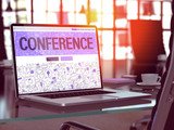 Conference Concept - Closeup on Landing Page of Laptop Screen in Modern Office Workplace. Toned Image with Selective Focus. 3D Render.