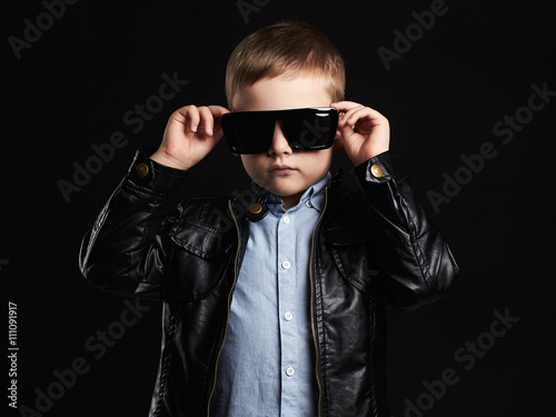 child in sunglasses.fashionable handsome little boy in leather. fashion trendy kids