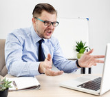 furious manager yelling at laptop