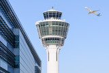 Fototapety Munich international airport control tower and departing taking off