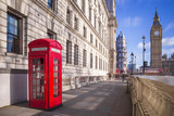 Traditional red british telephone box with Big Ben and Double Decker bus at the background on a sunny afternoon with blue sky and clouds - London, UK © zgphotography
