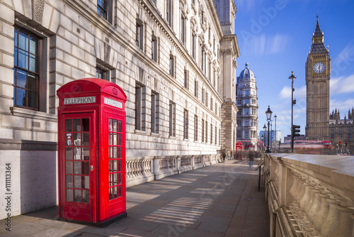 Traditional red british telephone box with Big Ben and Double Decker bus at the Poster