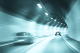 Tunnel dangerous high speed motion blurred vehicle driving. Turquoise blue color filter used. Motion blur visualise the speed and dynamics.