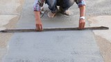 Man working on wet cement